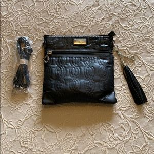 Black strapped purse with tassel